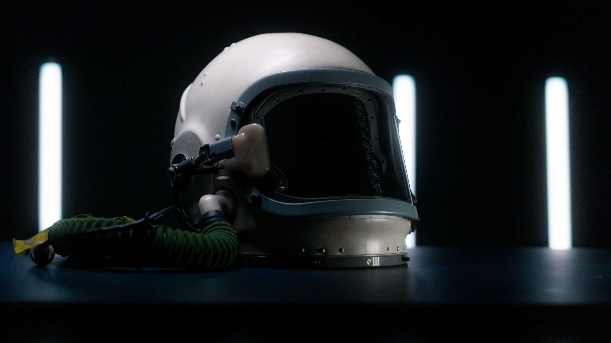 Space helmet with white lights in the background